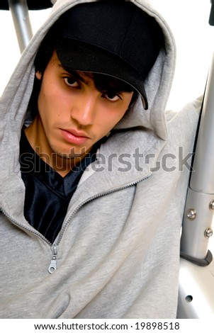 Handsome teenager boy, casual dressed, hip hop culture.  Studio shot, white background - stock photo