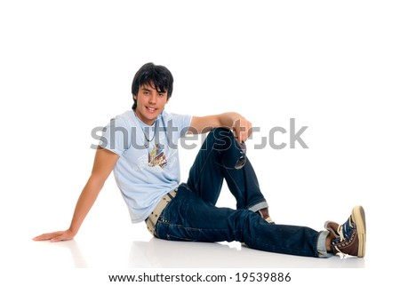 Handsome teenager boy, casual dressed, with sunglasses, hip hop culture.  Studio shot, white background - stock photo