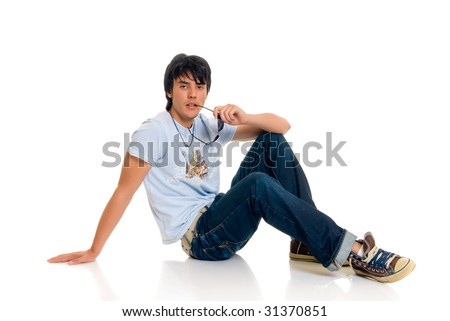 Handsome teenager boy, casual dressed, with sunglasses, hip hop culture.  Studio shot, white background