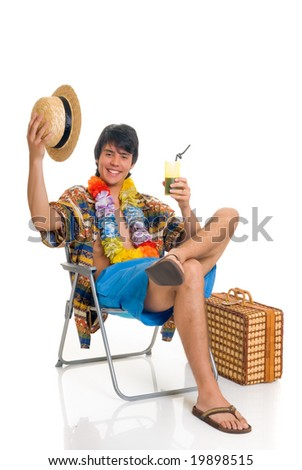 Handsome teenager boy on vacation, spring break, sitting in beach chair. Studio shot, white background. - stock photo