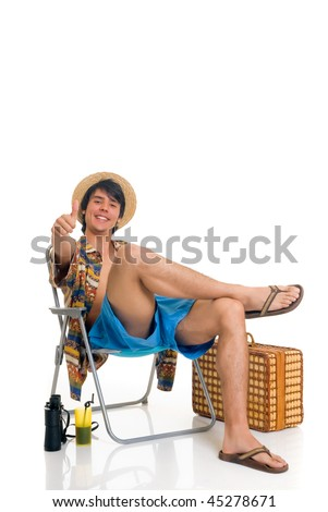 Handsome teenager boy on vacation, spring break, sitting in beach chair. Studio shot, white background.