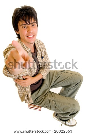 Handsome teenager boy student sitting on encyclopedia, casual dressed,  Studio shot, white background
