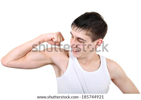 Handsome Teenager Muscle flexing Isolated on the White Background
