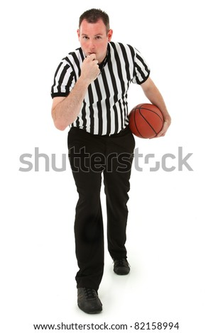 Handsome thirties basketball referee blowing whistle holding basketball. - stock photo