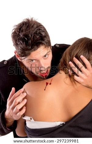 handsome vampire biting girl isolated in white background - stock photo