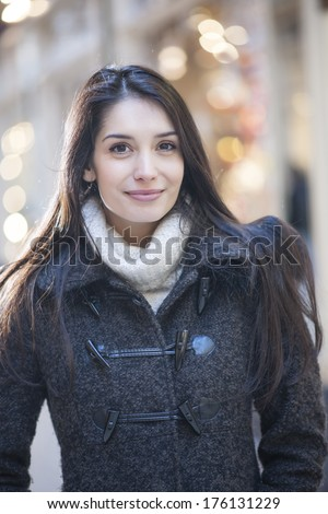 handsome woman portrait with city lights in background - stock photo