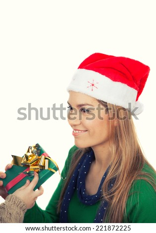 Handsome woman receiving Christmas present from her daughter. Isolated on white. - stock photo