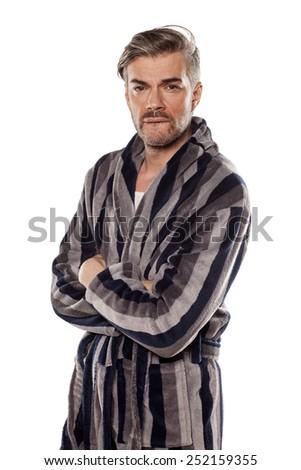 handsome worried man in a striped bathrobe - stock photo