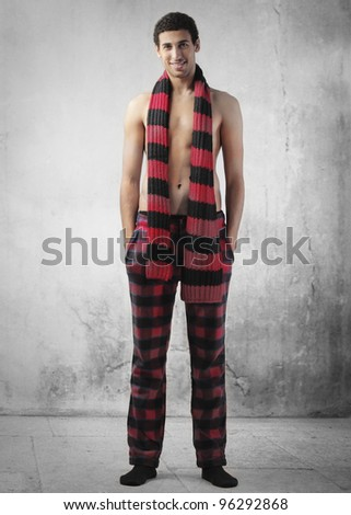 Handsome yong man with red and black clothes - stock photo