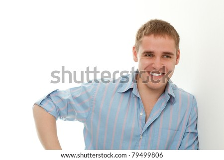 handsome young adult man portrait over white near wall - stock photo