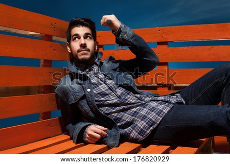 handsome young adult with blue jeans  posing for camera - stock photo