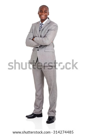 handsome young african american businessman with arms folded - stock photo
