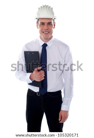 Handsome young architect holding clipboard and looking at you - stock photo