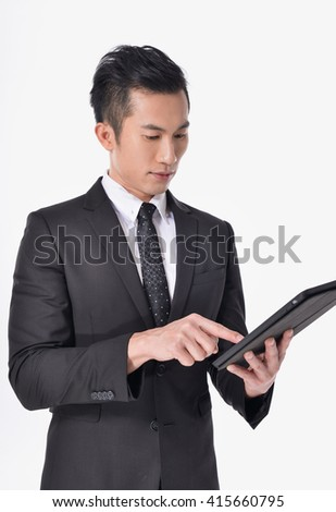 handsome young asian businessman Using Digital Tablet Isolated   - stock photo