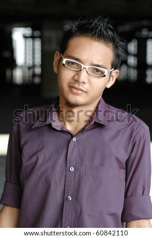 Handsome young Asian male with spectacles