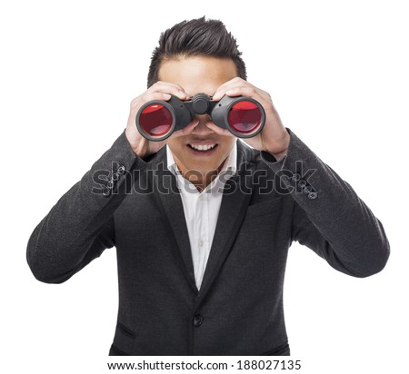 handsome young asian man looking trough a binoculars - stock photo