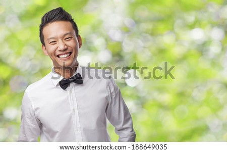 handsome young asian man wearing a shirt and bow