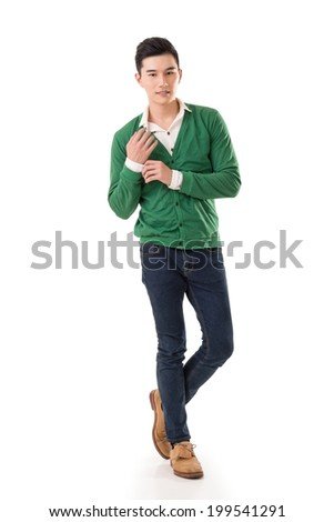 Handsome young Asian man with sweater, full length portrait isolated on white background. - stock photo