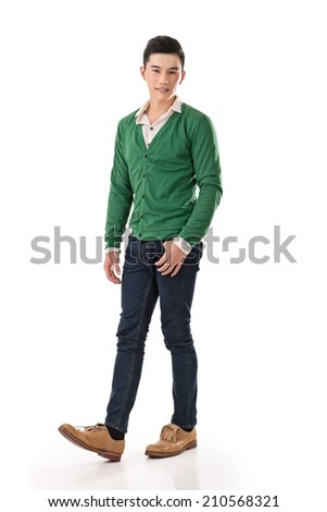 Handsome young Asian man with sweater, full length portrait isolated on white background.