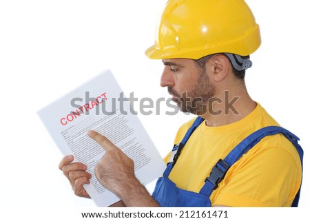 Handsome young bearded workman in a yellow hardhat and matching t-shirt holding a contract - stock photo