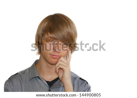 Handsome young, blue-eyed man with contemplative expression on white background. - stock photo