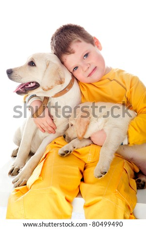 Handsome Young Boy Playing with His Two Dogs Against White Background - stock photo