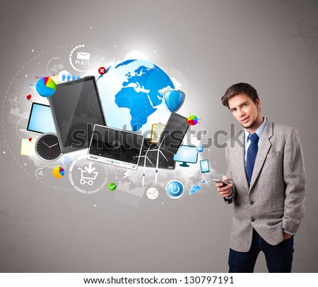 Handsome young boy standing and browsing on his phone - stock photo