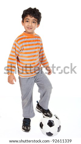 Handsome Young Boy Stands with Foot on Football, On White Background - stock photo