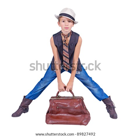 Handsome young boy wearing hat and with carpetbag (isolated on white) - stock photo