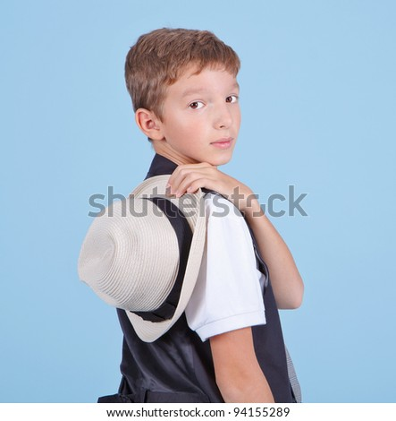 Handsome young boy with hat - stock photo