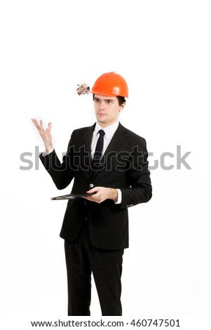 Handsome young builder and architect is working on a new project isolated on white background