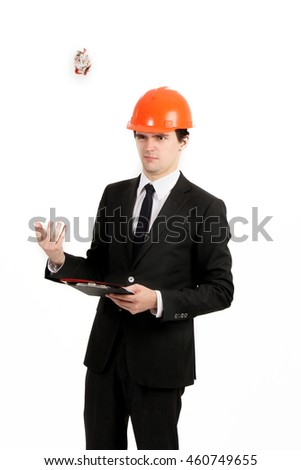 Handsome young builder and architect is working on a new project isolated on white background.