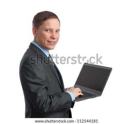 handsome young business man and laptop