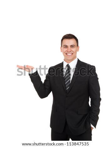 Handsome young business man happy smile, businessman showing something on the open palm, concept of advertisement product, empty copy space wear elegant suit and tie isolated over white background - stock photo
