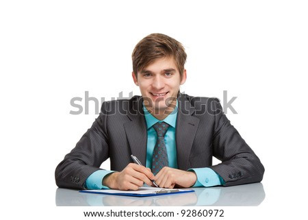 Handsome young business man happy smile, businessman working with documents sign up contract, sitting at the desk writing at office, wear elegant suit and tie isolated over white background - stock photo