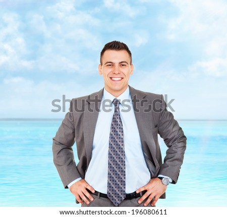 Handsome young business man happy smile summer ocean vacation, businessman with folded hands wear elegant gray suit and tie over sea blue sky - stock photo