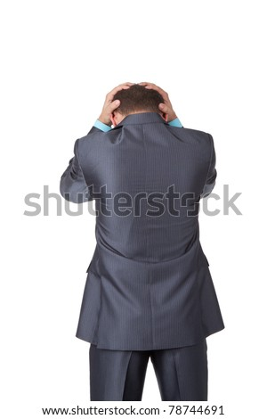 Handsome young business man in modern elegant suit standing back holding head with his hands, isolated over white background. Concept of neck or head ache, pain, problem, tired up. - stock photo