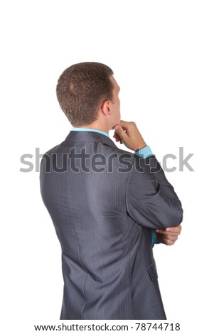 Handsome young business man in modern elegant suit standing back, isolated over white background. Concept of idea, ask question, think up, choose, decide, - stock photo
