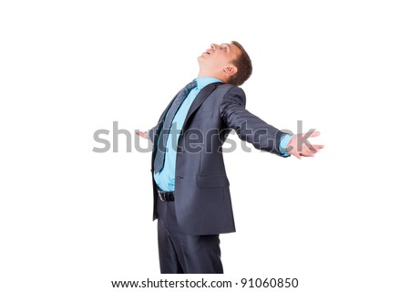 Handsome young business man in modern elegant suit standing looking up, isolated over white background. Concept of idea, ask question, think up, choose, decide, wait. - stock photo
