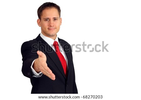 Handsome young business man saying welcome and giving you his hand - stock photo