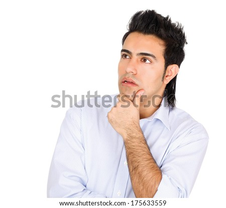 Handsome young business man standing with folded arms on white background