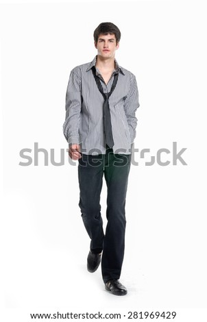 handsome young business man walkingâ??full body - stock photo