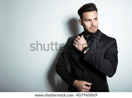 handsome young business man with wrist watch - stock photo