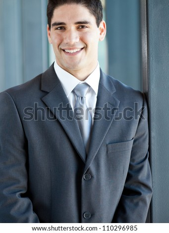 handsome young businessman closeup portrait - stock photo