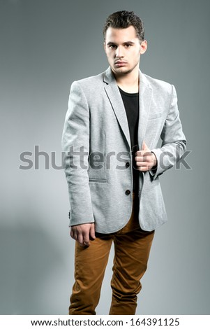Handsome young businessman in studio