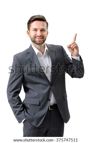Handsome young businessman pointing to something - stock photo