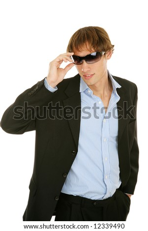Handsome young businessman removing his sunglasses.  Isolated on white. - stock photo