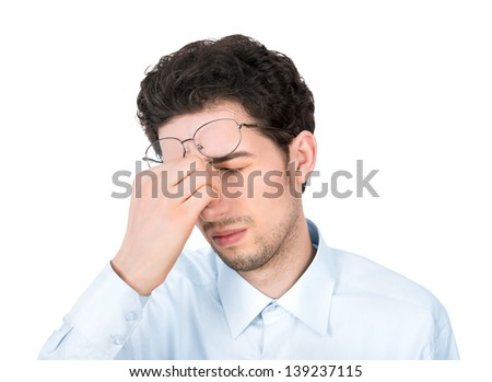 Handsome young businessman showing tired or headache gesture. Isolated on white background. - stock photo