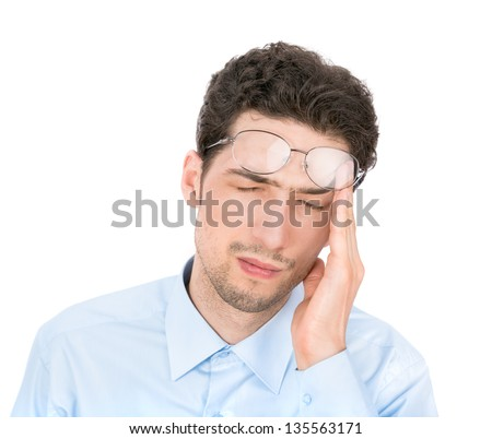 Handsome young businessman suffers from a headache. Isolated on white background.