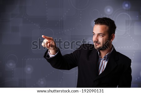 Handsome young businessman touching copy spase - stock photo